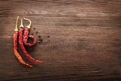 Red hot chili pepper on wood. Background Stock Photography