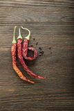 Red hot chili pepper on wood Stock Images