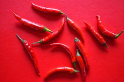 Red hot chili peppers on red background stock photography