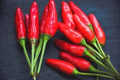 Red hot Chili peppers. On black slate Stock Images