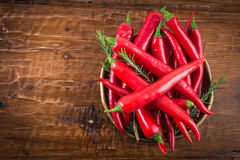 Red hot chili peppers. In bowl on rustic wood background Stock Image