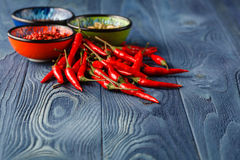 Red Hot Chili Peppers in bowl on rustic wood background.Space fo Stock Images