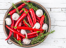 Red hot chili peppers. In bowl on white wood background.Fresh spices Stock Photos