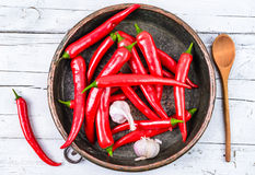 Red hot chili peppers. In bowl on wood background.Fresh spices Royalty Free Stock Photo
