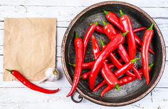 Red hot chili peppers. In bowl on wood background.Fresh spices.Space for text Stock Image