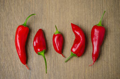 Red hot chili peppers on a brown wooden background Royalty Free Stock Photography