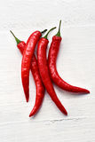 Red hot chili peppers. Bunch of colourful red hot chili peppers or capsicum used as a pungent flavouring and spice in cooking or dried to produce cayenne pepper Stock Photography