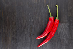 Red hot chili peppers. Delicious red hot chili peppers on a wooden table Royalty Free Stock Image