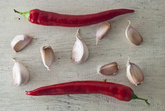 Red hot chili peppers and garlic Royalty Free Stock Photo