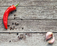 Red hot chili peppers with garlic on wood. En background Stock Photography