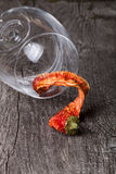 Red hot chili peppers in a glass on a dark wooden background Stock Images