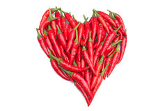 Red hot chili peppers in a heart shape. On white background Stock Photo