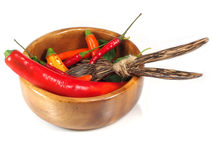 Red Hot Chili Peppers with herbs and spices over white backgroun Royalty Free Stock Photography