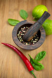 Red Hot Chili Peppers, lime and spices with Mortar and Pestle Royalty Free Stock Photos
