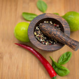 Red Hot Chili Peppers, lime and spices with Mortar and Pestle Stock Image