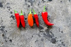 Red hot Chili peppers. On old stone background Stock Photography
