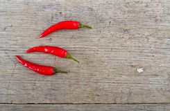 Red hot chili peppers on wooden table Stock Images