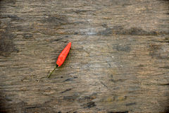 Red Hot Chili Peppers over wooden background copy space Royalty Free Stock Image