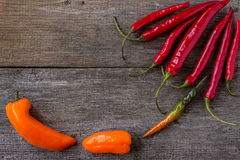 Red Hot Chili Peppers over wooden rustic  table Stock Images