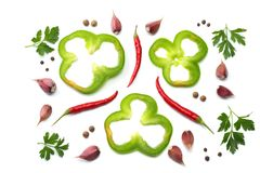 Red hot chili peppers with parsley, garlic and cut slices of green sweet bell pepper isolated on white background top view royalty free stock images