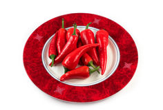 Red hot chili peppers on a plate isolated Stock Photos