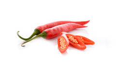 Red hot chili peppers with stem on white. Background Stock Photography