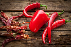 Red hot chili peppers, sweet pepper on wooden table Stock Photography