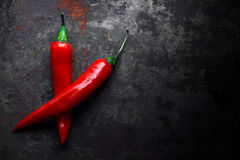 Red hot chili peppers. On vintage background Royalty Free Stock Images