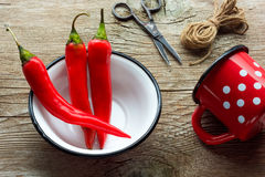 Red hot chili peppers. On vintage background Royalty Free Stock Photos