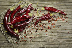 Red hot chili peppers whole and crushed Stock Photography