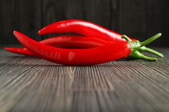 Red hot chili peppers. On wood closeup Stock Images