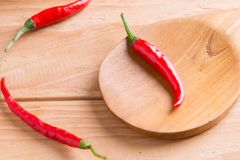 Red hot chili peppers on wood Stock Photography