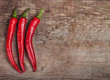 Red hot chili peppers on a wood. En board Royalty Free Stock Image