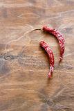 Red hot chili peppers on wooden background Royalty Free Stock Images