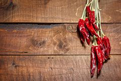 Red hot chili peppers on a wooden background royalty free stock images
