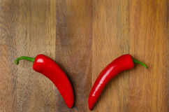 Red hot chili peppers on a wooden background, horizontal Stock Photos