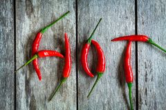 Red hot chili peppers on a wooden background Stock Photos