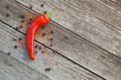 Red hot chili peppers on wooden background Royalty Free Stock Image