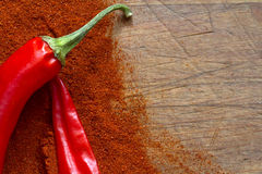 Red hot chili Peppers on wooden board Royalty Free Stock Photos