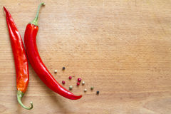 Red hot chili Peppers on wooden board Royalty Free Stock Images