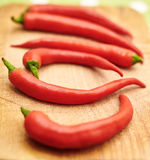 Red hot chili peppers on wooden board Royalty Free Stock Photo
