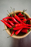 Red hot chili peppers. In a wooden bowl Stock Photography