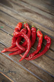 Red hot chili peppers. On wooden table Royalty Free Stock Photos