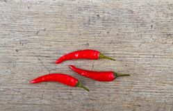 Red hot chili peppers on wooden table Stock Image