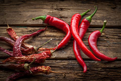 Red hot chili peppers on wooden table Stock Photo