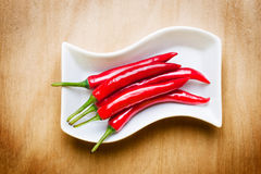 Red hot chili on wood table Royalty Free Stock Photography