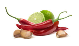 Red hot chilie pepper, garlic cloves, lime  on white Stock Photo