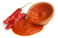 Red hot chilies with paste Stock Photography