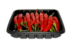 RED HOT Chilis. Red chilis in a box Stock Photo