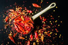Red hot Chilli Chillies pepper on black. Red Hot Chilli Chillies pepper, dried and crushed Stock Images